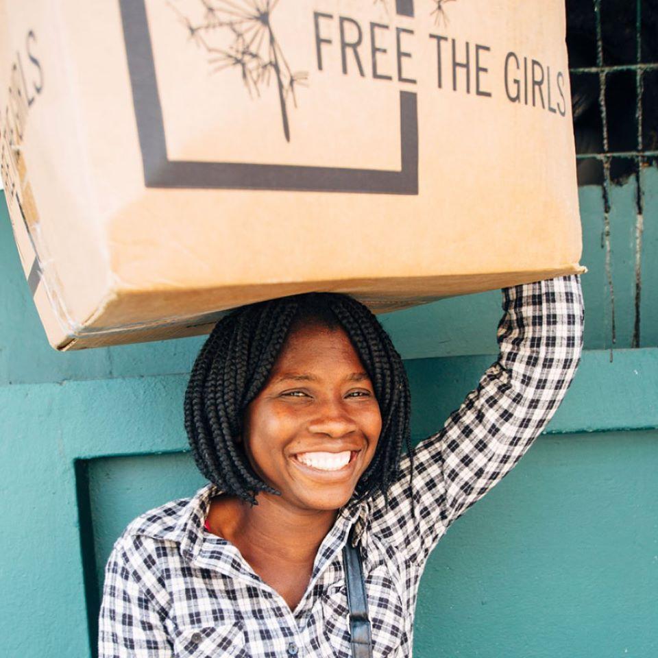 A female survivor of human trafficking unboxes bras.