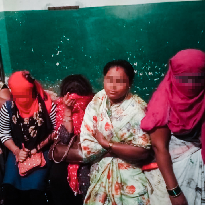 Four Indian female survivors of human trafficking sit together following a successful rescue operation.