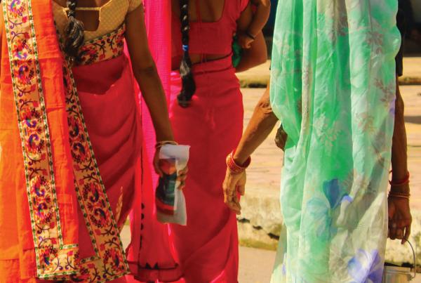 Representative image of three female Indian survivors of human trafficking, walking away from camera.